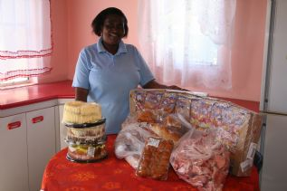 Vuyo as pleased as punch with the donations from Miracle Meals and Mount Pleasant SPAR