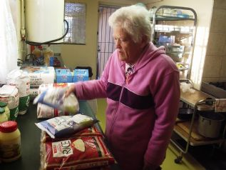 Norma taking stock of the SPAR trolly dash donation